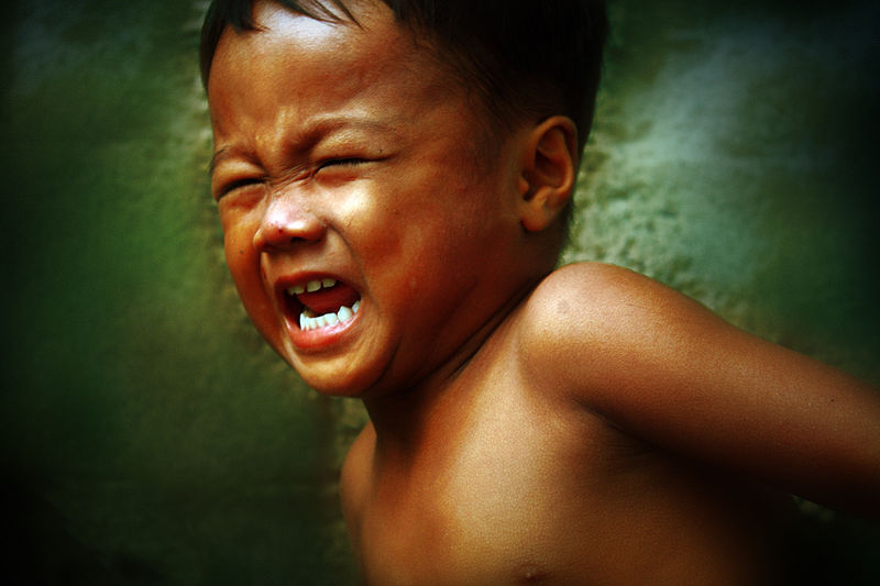 Photo of child crying angrily, by Allan Donque